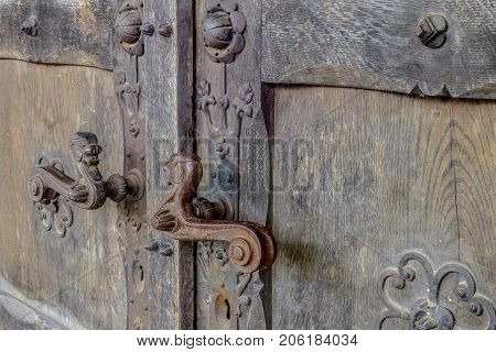 Old wooden door with antique copper handle