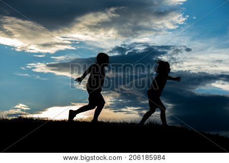 Silhoutte of two brothers enjoying the freedom
