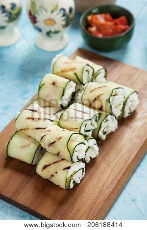 Grilled zucchini rolls filled with fresh cottage cheese