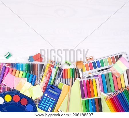 Colorful stationery supplies donations, top view with copy space