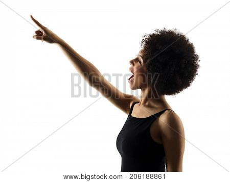 one mixed race african young teenager girl woman pointing  in studio shadow silhouette isolated on white background