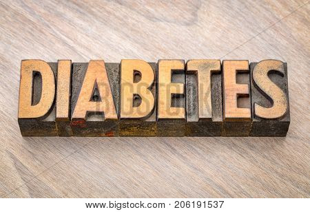 diabetes  - health problem - word in vintage wood letterpress printing blocks against grained wooden background