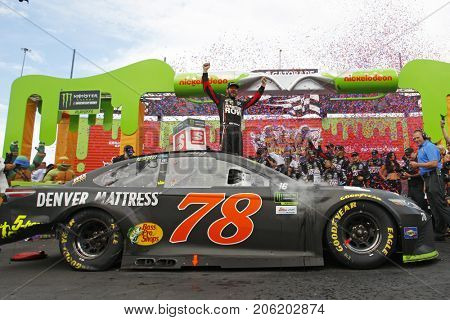 September 17, 2017 - Joliet, Illinois, USA: Martin Truex Jr (78) takes the checkered flag and wins the Tales of the Turtles 400 at Chicagoland Speedway in Joliet, Illinois.