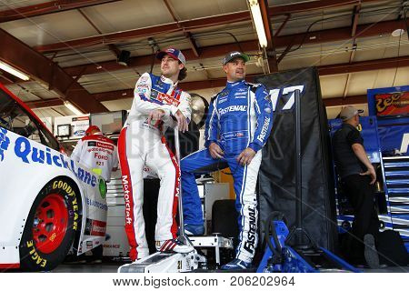 September 15, 2017 - Joliet, Illinois, USA: Ricky Stenhouse Jr (17) and Ryan Blaney (21) hangs out in the garage before the Tales of the Turtles 400 at Chicagoland Speedway in Joliet, Illinois.