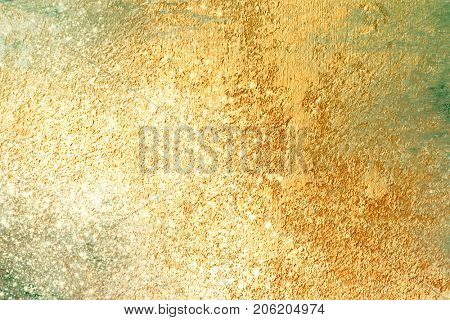 Gold background with sparkling glitter effect - abstract Christmas texture