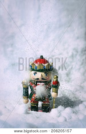 Nutcracker figure in snow scene with falling snow