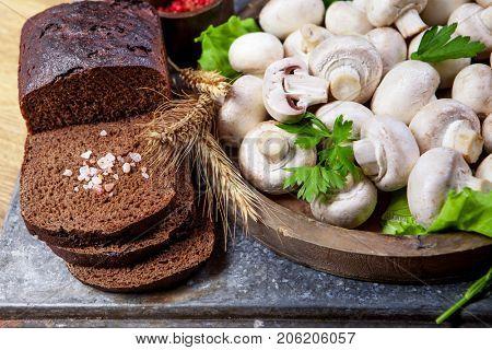 Fresh champignon mushrooms on wooden table