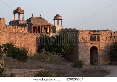 Fortified gate at Nagaur's fort in Rajasthan during sunset.