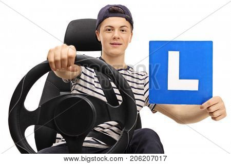 Teenage boy driving and showing an L-sign isolated on white background