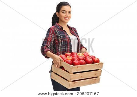 Female farmer holding a wooden crate filled with apples isolated on white background