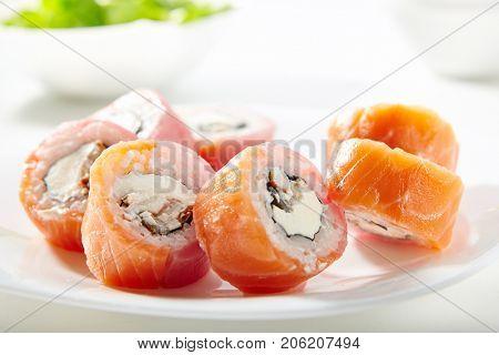 Philadelphia Sushi Roll - Maki Sushi with Philadelphia Cheese inside. Salmon and Tuna outside