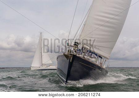 Two sailing boats, sail boat or yachts at sea