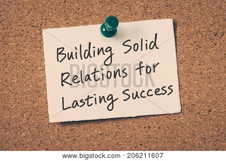 business relationship building reminder message on a cork board