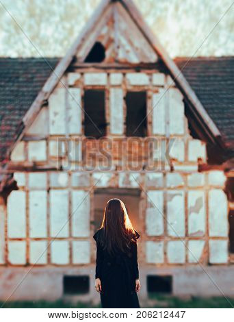 Evil Ghost in Front of a Horror Haunted Abandoned House