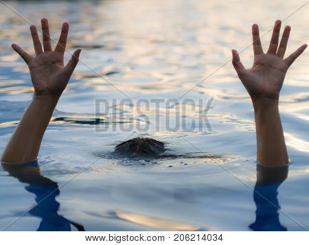 Drowning victims Hand of drowning woman needing help selective focus. Failure and rescue concept.