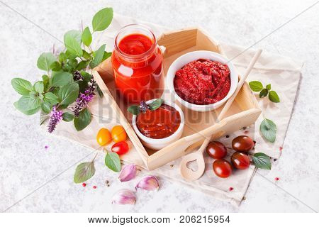 homemade tomatoes in glass jar - food and drink