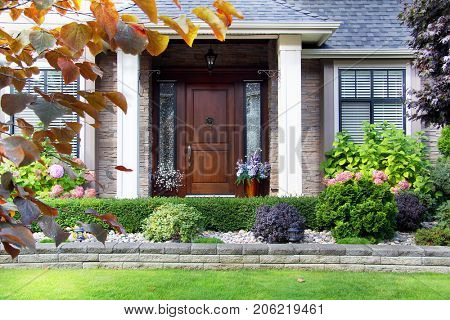 Front door facade of a luxury home in a Canada.