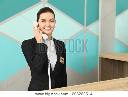 Female receptionist working in hotel