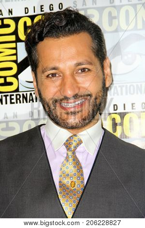 Cas Anvar arrives at the 2017 Comic Con press room at the Hilton San Diego Bayfront hotel on July 22, 2017 in San Diego, CA.