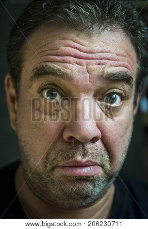 Close-up portrait of a sad unshaven adult man
