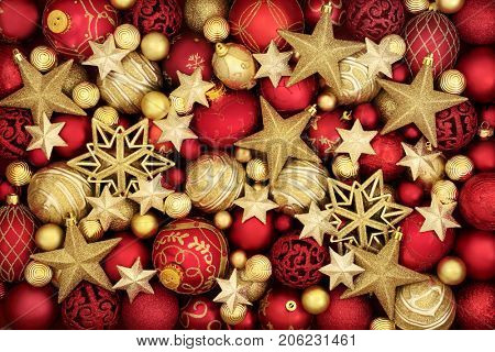 Christmas decorative background with red and gold bauble decorations.
