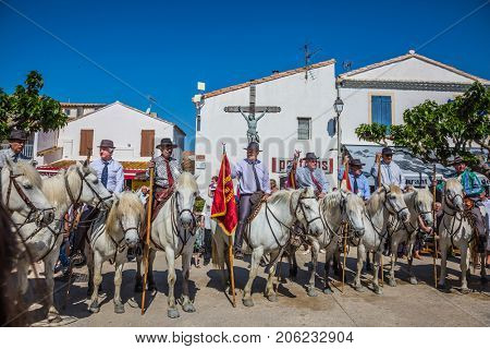 Sent-Mari-de-la-Mer, Provence, France - May 25, 2015.  The concept of ethnographic tourism. Convoy - guards on white horses before the start of the parade. World Festival of Gypsies
