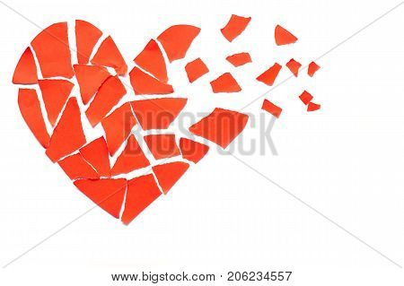 Broken heart breakup concept separation and divorce icon. Red crumpled paper shaped as a torn love