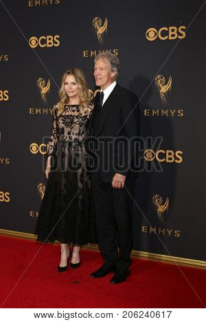 LOS ANGELES - SEP 17:  Michelle Pfeiffer, David E Kelley at the 69th Primetime Emmy Awards - Arrivals at the Microsoft Theater on September 17, 2017 in Los Angeles, CA