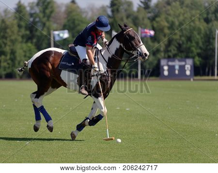 TSELEEVO, MOSCOW REGION, RUSSIA - JULY 26, 2014: Unidentified player of British schools with mallet in the match against Moscow Polo Club during the British Polo Day