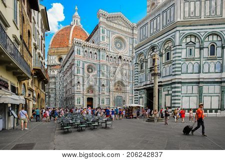 FLORENCE,ITALY - JULY 22,2017 : Tourists at Piazza del Duomo with a view of the Cathedral of Florence