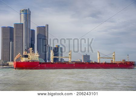 DETROIT, MI - APRIL 8, 2017:  View of barge navigating the Detroit river with General Motors Building and downtown Detroit in the background.