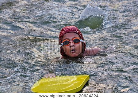 Young, Asian, Bengali Boy Swimming, Being Trained With A Floating Board