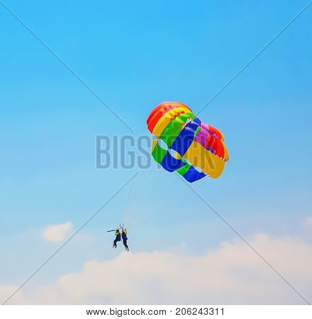 Two people parachuting on sunny summer day