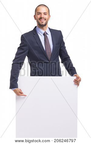 Young business man holding a white banner on a white background