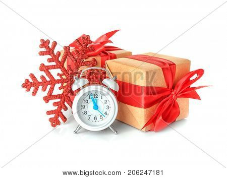 Composition with clock and festive decor on white background. Christmas countdown concept