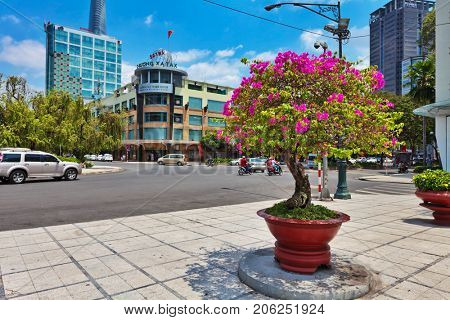 HO CHI MINH, VIETNAM - APRIL 28, 2014: View at one of central streets of Ho Chi Min city with Bitexco Financial Tower on background. Its construction was completed in 2010.