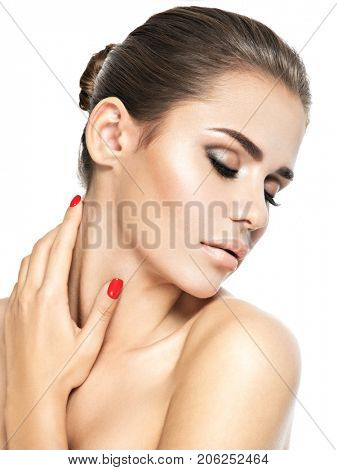 Portrait of young woman with closed eyes. Woman touching neck