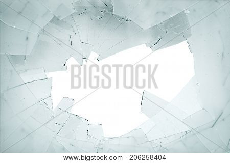 Broken window. Shards of glass on a white background