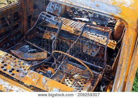 Burned car.Rusty Machine.
