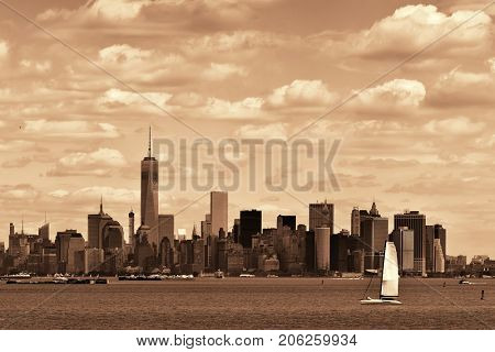 Manhattan downtown skyline with urban skyscrapers and cloud.