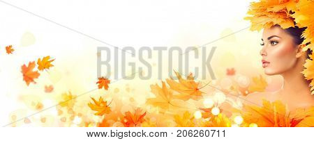 Autumn woman. Fall. Beauty model girl with autumn bright leaves hairstyle. Beautiful Fashion female with Autumnal Make up and Hair style. Creative Autumn Makeup. Beautiful Face, isolated on white