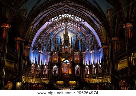 MONTREAL, CANADA - SEPTEMBER 14, 2017:  Nave of Notre Dame Basilica in old Montreal in Canada.  Built in the Gothic Revival style, the church is highly decorated.