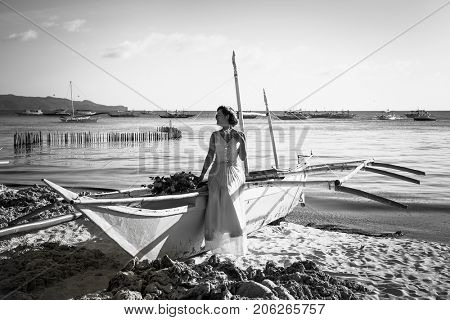 BORACAY, PHILIPHINES- MARCH 17, 2017: Beautiful asian bride posing on a boat by the sea. Boracay on March 17, 2017. Philiphines.