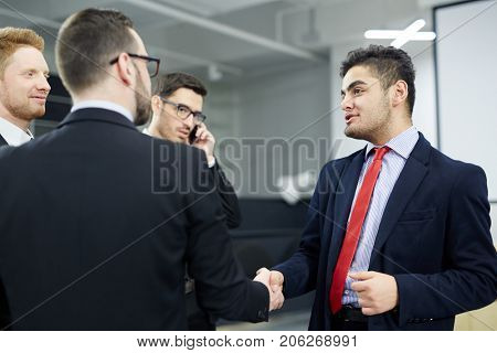 Successful politicians greeting one another by handshake after meeting