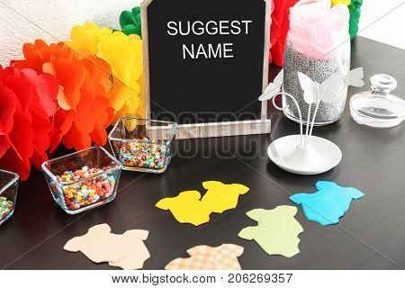 Game for suggestion baby name on table at shower party