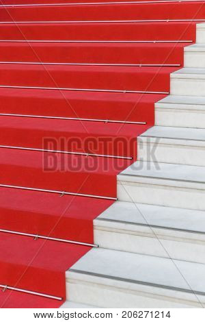 Red carpet on stairs in Cannes Film Festival - art background