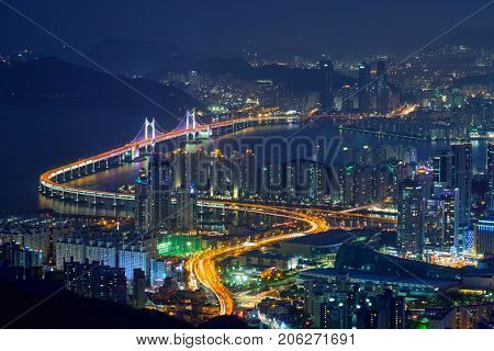 Busan cityscape with skyscrapers and Gwangan Bridge illuminated at night. Busan. South Korea