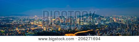 Panorama of Seoul downtown cityscape illuminated with lights and Namsan Seoul Tower in the evening view from Inwang mountain. Seoul, South Korea. poster