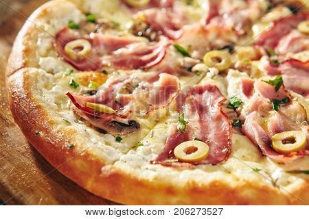 Pizza Restaurant Menu - Delicious Fresh Pizza with Bacon and Olives. Pizza on Rustic Wooden Table with Ingredients