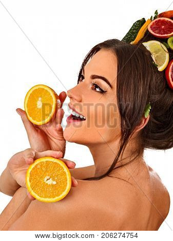 Hair mask from fresh fruits on woman head. Bare back hold halves of orange for organic skin and body therapy. Concept of healthy and beauty on isolated. Masks made from natural ingredients for hair.
